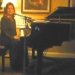 vicki-sitting-at-piano-at-calusa